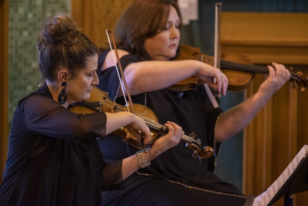 Kirsten Williams and Doreen Cumming playing violin
